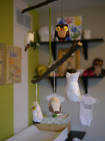 This is the owl mobile I made from a stick from the woods and owls- some that I made and some that I bought.  the little yellow and brown owl was purchased at a yard sale for 10 cents.  :)
