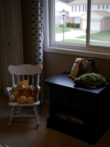 We got Alex one nightstand to match his dresser and crib/bed.  I keep all his teeny tiny little socks in the drawer.  The rocking chair was a gift from a former coworker.