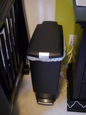 My husband decided that the cheapo trash can I bought to use as a diaper pail was sub par, so he upgraded to this fancy step-to-open one.... it is nice.