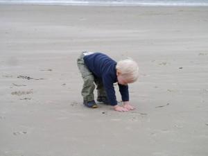Alex enjoying some Oregon sand